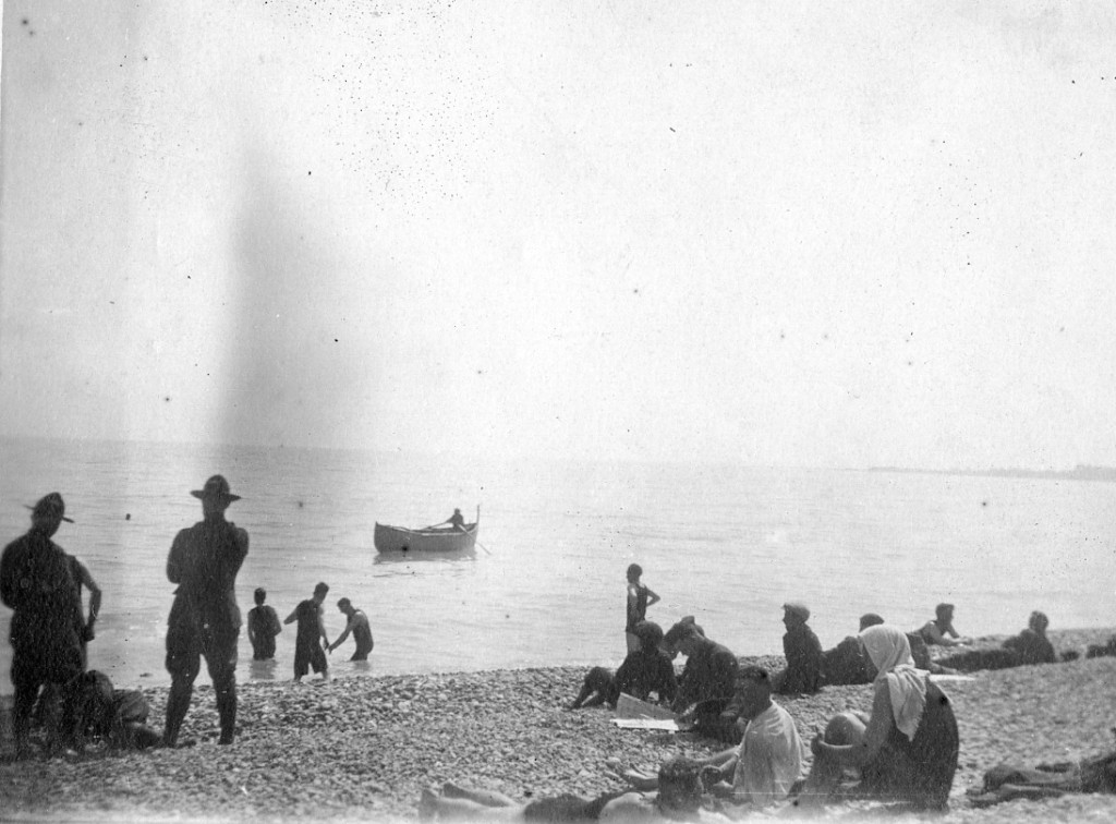 Soldiers visit the beach along the Mediterranean Sea in France.